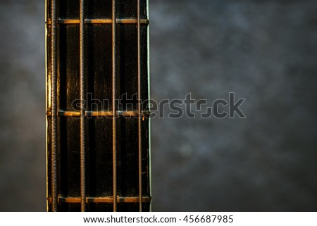 guitar fretboard illuminated beam of light, vertical view - stock photo
