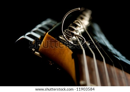 guitar head on the black - stock photo