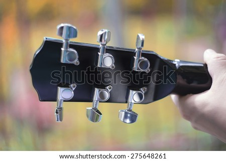 Guitar head with lens blur - stock photo