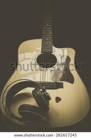 Guitar ,headphone and guitar pick - stock photo