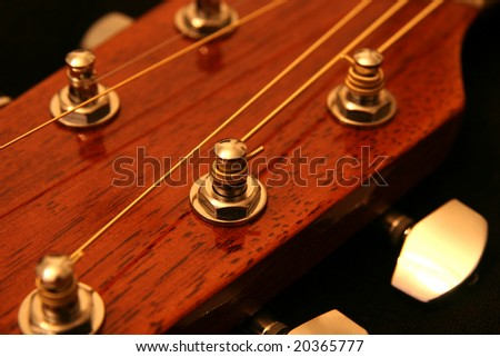 Guitar headstock, neck and tuning peg. Tension or highly strung concept.