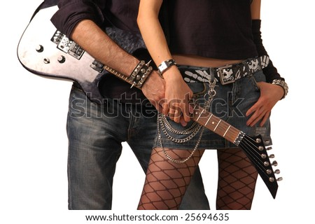 Guitar holding by rock couple - stock photo
