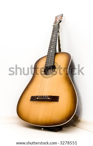 Guitar in a corner of room. Bottom view. Wide angle. - stock photo