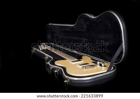 Guitar in case on black background - stock photo