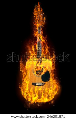 Guitar in flames on a black background - stock photo