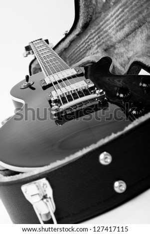 Guitar in open case isolated on the white background - stock photo