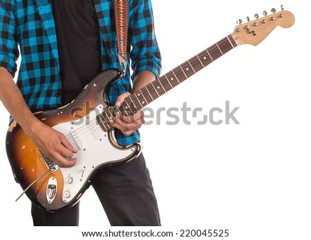 Guitar in the hands of man. Located on the white background.