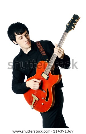 Guitar man. Guitarist Playing six-string electric red guitar on white background. - stock photo