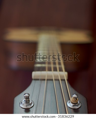 Guitar neck and strings looking from the head towards the body