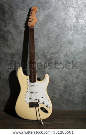 Guitar on blue background - stock photo