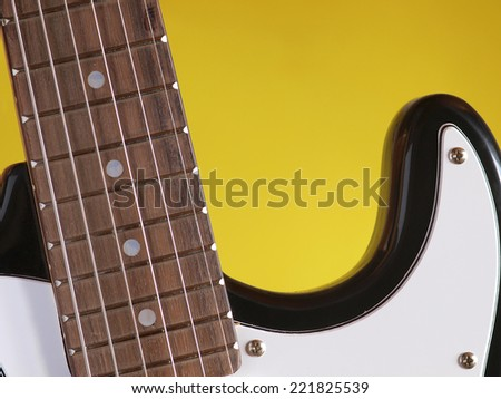 Guitar on yellow background