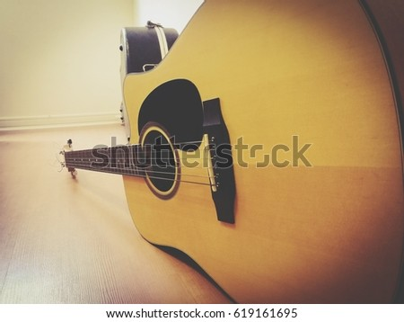 Guitar placed in the bedroom and on the floor