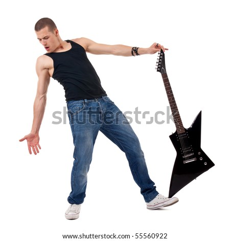 guitar player holding his guitar on balance on his foot, over white - stock photo