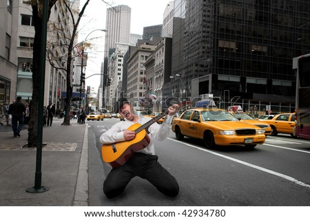 guitar player in a ny street - stock photo