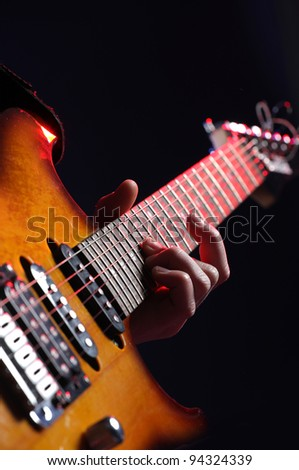 guitar player in action on stage - stock photo