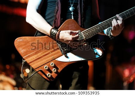 Guitar player in detail - stock photo