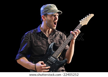 Guitar player isolated against black background - stock photo