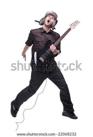 Guitar player jumping in midair isolated against white background - stock photo