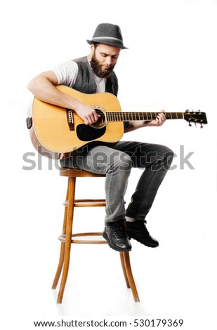 Guitar player playing and singing