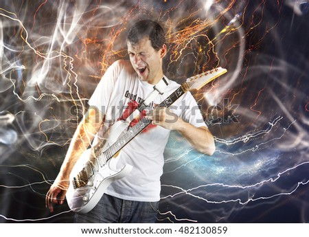 Guitar player with white electric guitar surrounded by lightnings