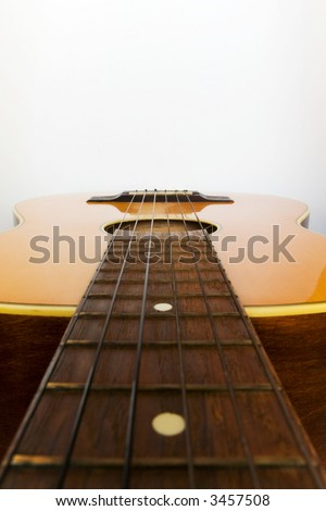 Guitar positioned horizontal to have space at top of image for designers - stock photo
