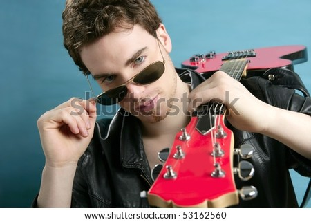guitar rock star man sunglasses and leather perfect jacket over blue - stock photo