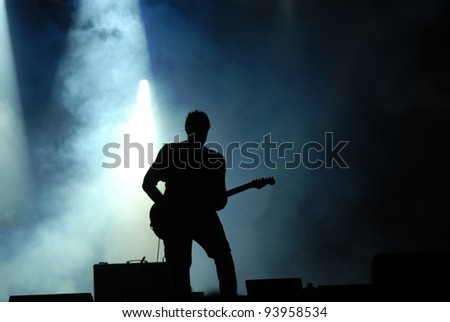 guitarist at concert - stock photo