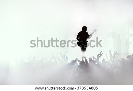 guitarist at rock concert - stock photo