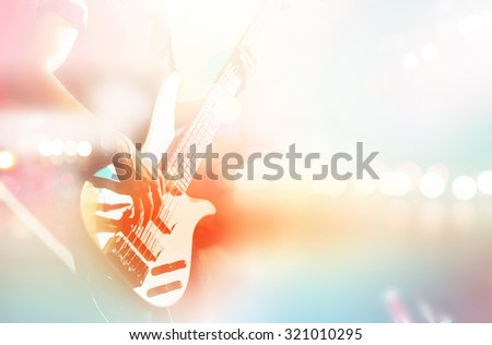 Guitarist bass on stage for background, colorful, pastel tone and soft focus  - stock photo