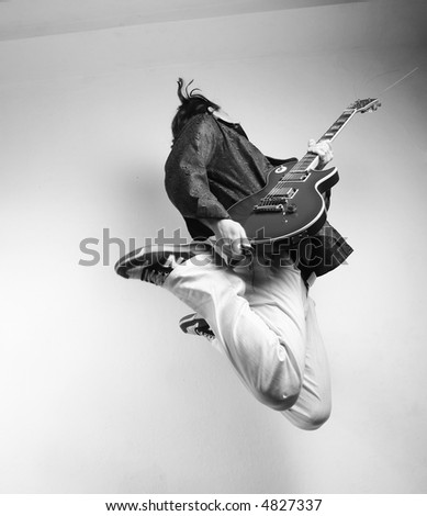 guitarist jumps - stock photo