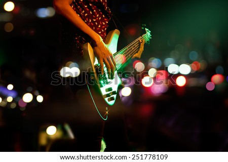 Guitarist on stage abstract colorful background, soft and blur concept - stock photo