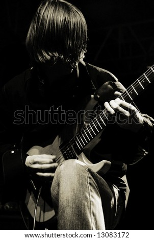 guitarist plaing by guitar on concert - stock photo