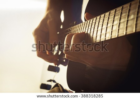 guitarist playing electric guitar close-up shot - stock photo