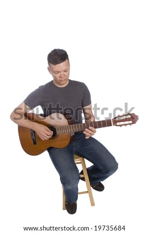 Guitarist playing isolated on a white background