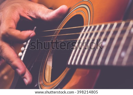 Guitarist Playing on his Instrument