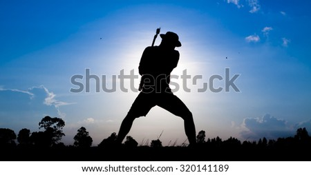 Guitarist Playing Rock Music Against with blue sunset background
