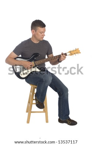 Guitarist playing while isolated on white