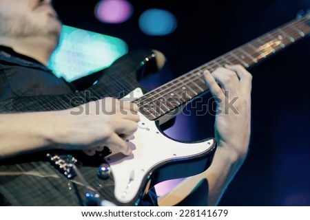 Guitarist solo on electric guitar - stock photo