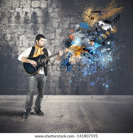 Guitarist with colorful splash effect - stock photo