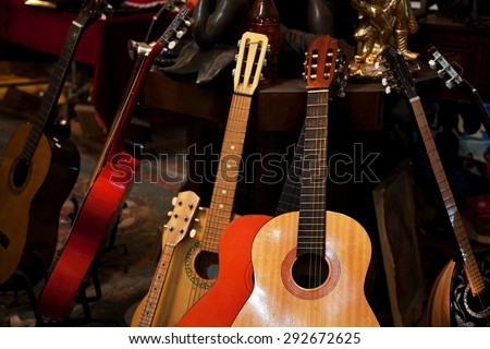 guitars composition in a vintage shop - stock photo