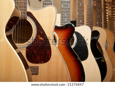 Guitars hanging on wall of music studio - stock photo