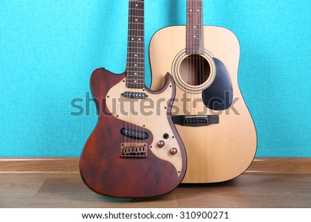 Guitars on blue wallpaper background - stock photo