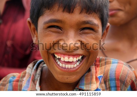 GUJRANWALA, PAKISTAN - JULY 24, 2014: Portrait of an unidentified boy on the street in  city of Gujranwala, Pakistan