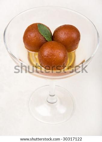 Gulab jamun, Milk ball in sugar syrup - stock photo