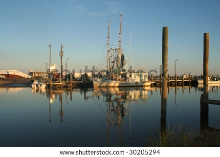 Gulf Coast Shrimp Boat at Harbor with Reflections on Calm Ocean Waters