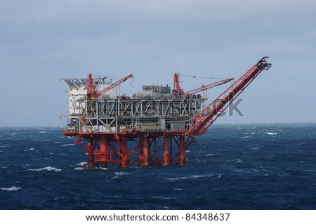 Gulf of Mexico oil drilling rig in stormy seas - stock photo