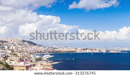 Gulf of Naples panoramic landscape with cityscape under blue cloudy sky - stock photo