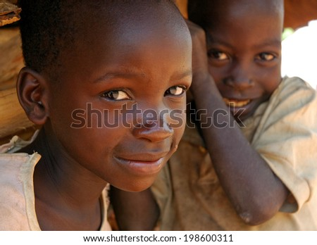 GULU, UGANDA, AFRICA - CIRCA MAY 2005: Unidentified children circa May 2005 in Uganda, Africa. Uganda remains challenged by an ongoing civil war displacing thousands of children.  - stock photo