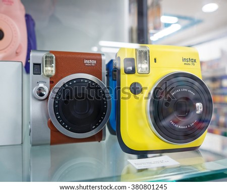 GUM Shop, Moscow, Russia - February 21, 2016: Showcase with Instax Fujifilm cameras, shallow depth of field  - stock photo
