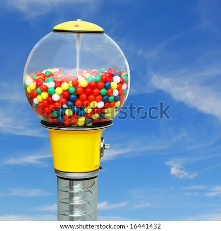 Gumball machine with colorful chewing gum balls on square blue sky background - stock photo